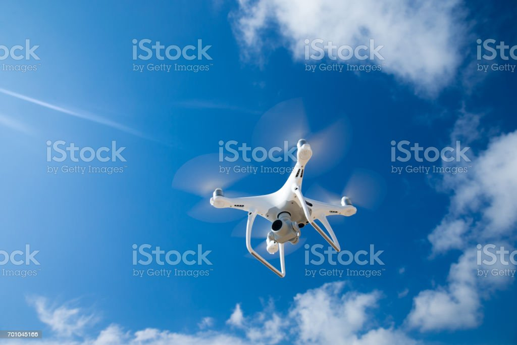 Drone fly in the blue sky stock photo