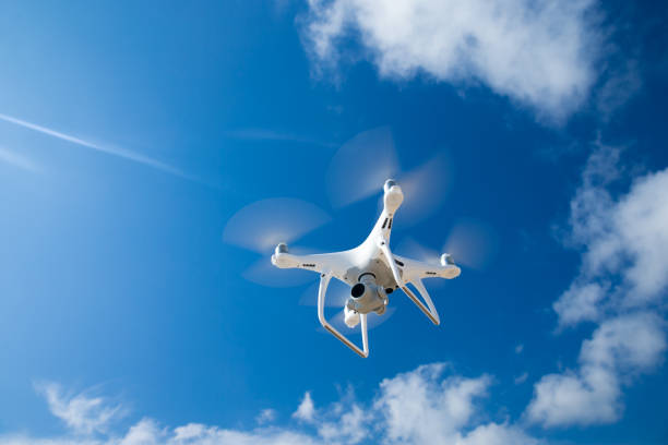 drone fly in the blue sky - drones stock photos and pictures