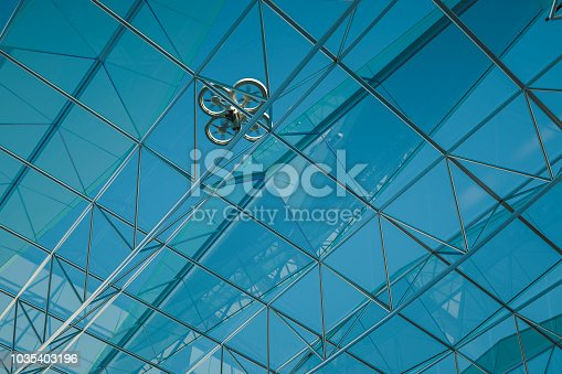 istock Drone fly with building 1035403196