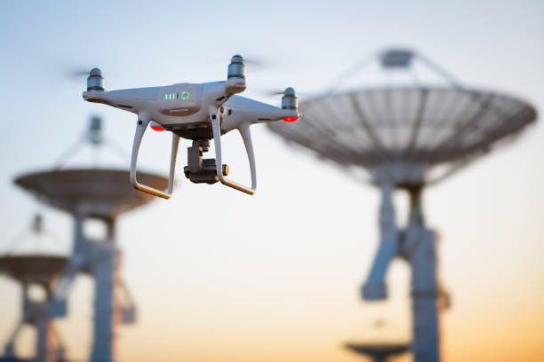 drone flying at the satellite antenna array - drones stock pictures, royalty-free photos & images
