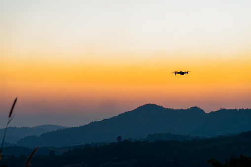 istock Drone flying in sunset on hilltop 1196505757