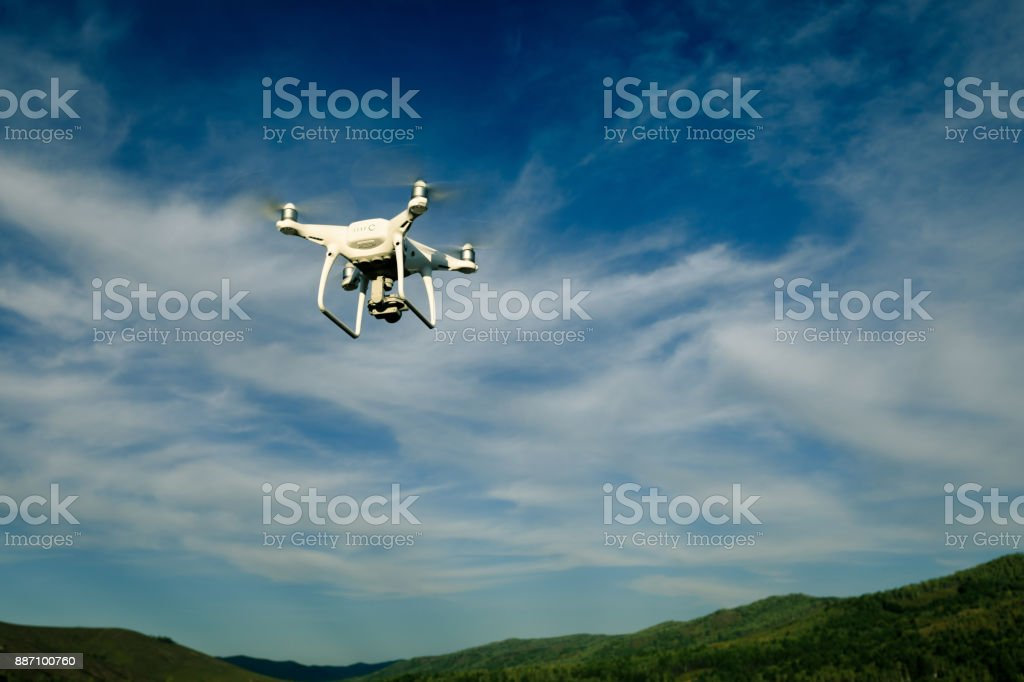 drone flying in the air over forest – zdjęcie