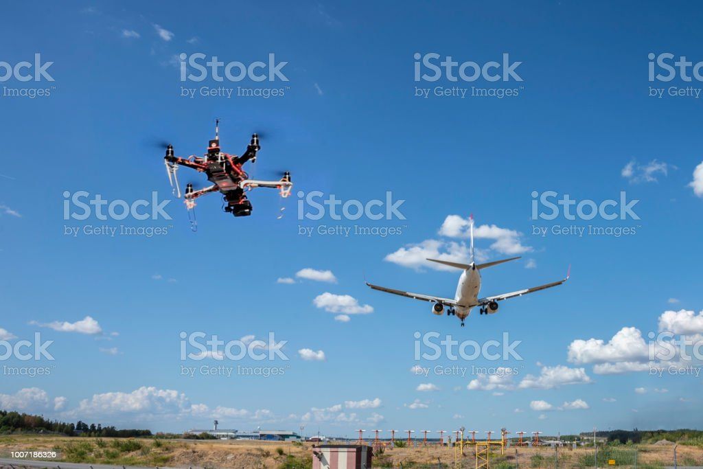 A drone flying near an airport stock photo