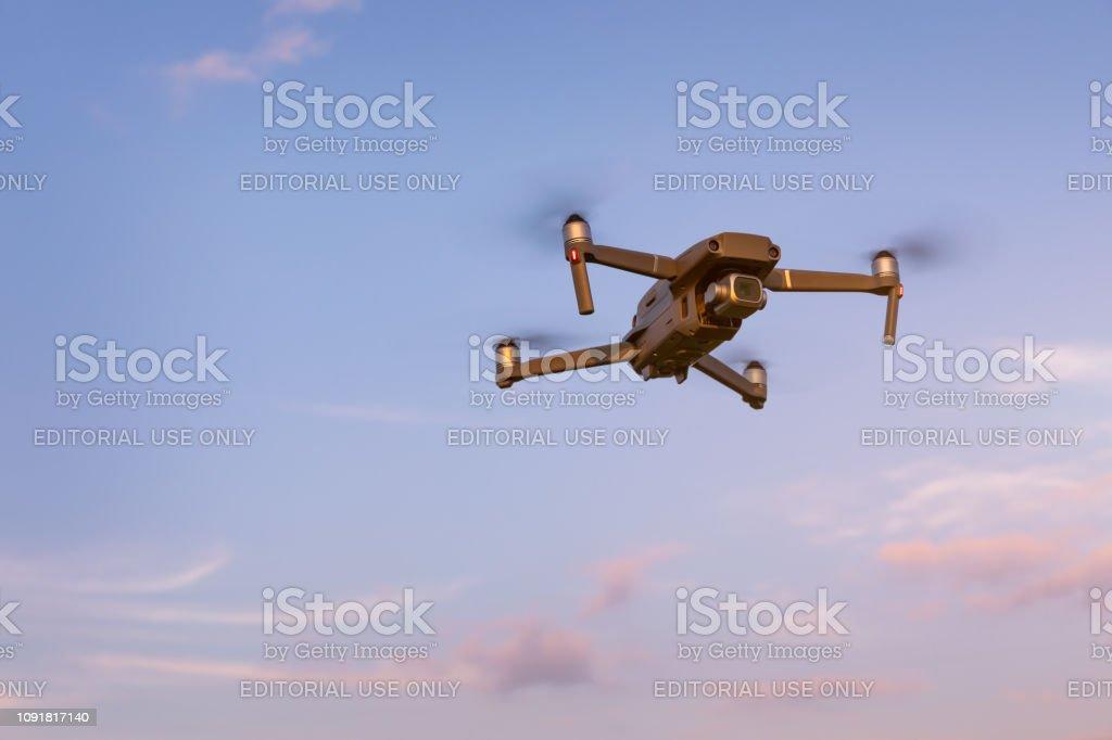 Drone flying over landscape. UAV drone copter flying with digital...