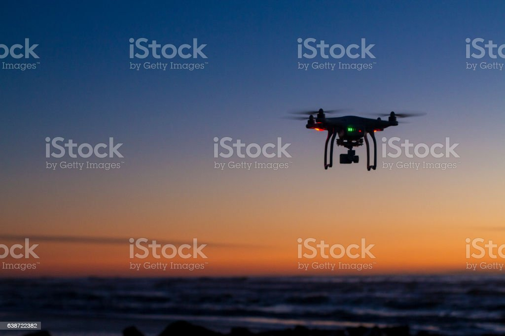 Drone flying over ocean at dawn stock photo