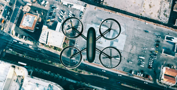 drone hoovers over city in high angle view - drones stock photos and pictures