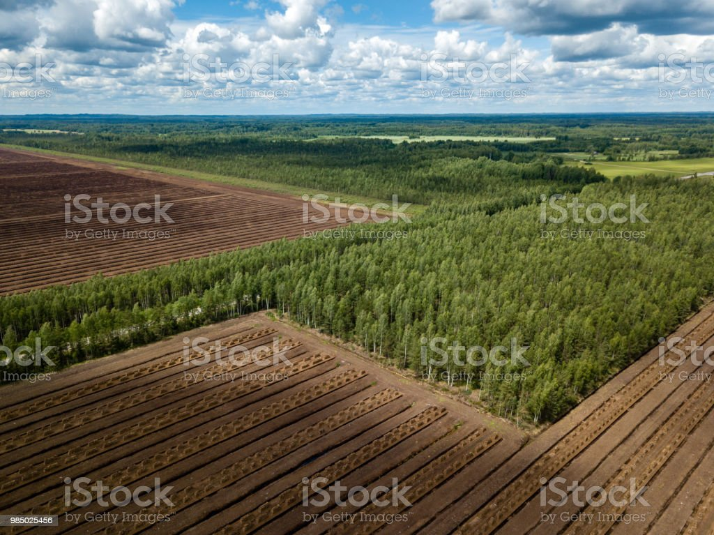 drone image. aerial view of rural area with fields of turf fuel cells...