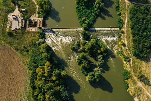 Drone image of wide river and water level control plant - stock image