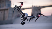 A DJI Inspire 2 flown in Los Angeles. The camera hangs below and the landing gear rises up out of the frame. The drone is beginning a hard left movement here.