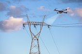 drone inspecting electricity power lines