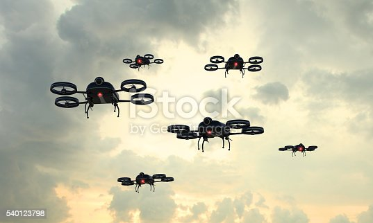 Drone invasion: fleet of remote controlled black drones flying in the sky. Rising popularity of civil drones is creating a new kind of sky traffic, with safety concerns. Composite image with digitally generated drone.