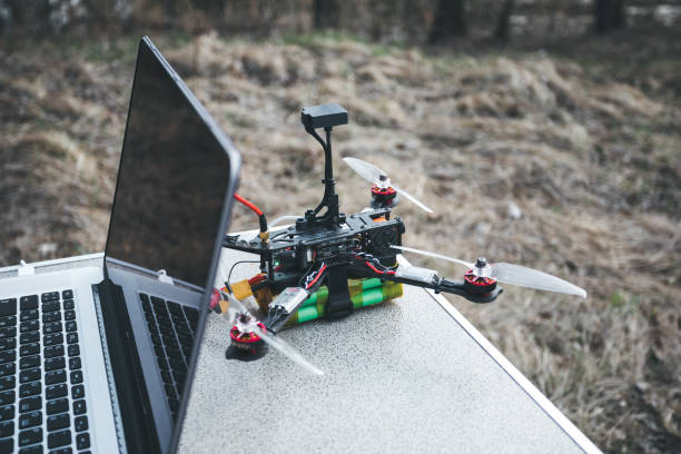 FPV drone lies on the table near the laptop and control panel. stock photo