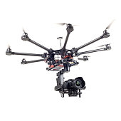 Copter closeup isolated on a white background. The aircraft with a raised chassis. The professional copter.