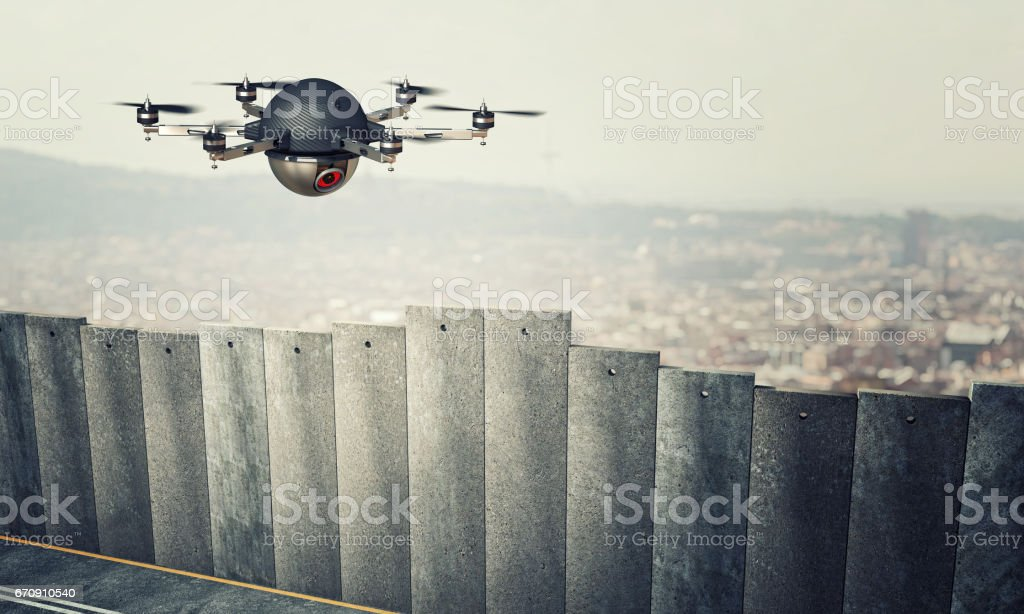 drone on border wall stock photo