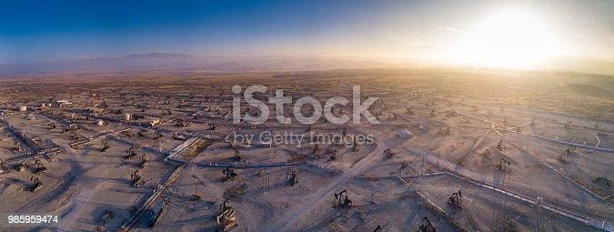 Drone shot looking down on the vast Kern River Oil Field near Bakersfield, California.