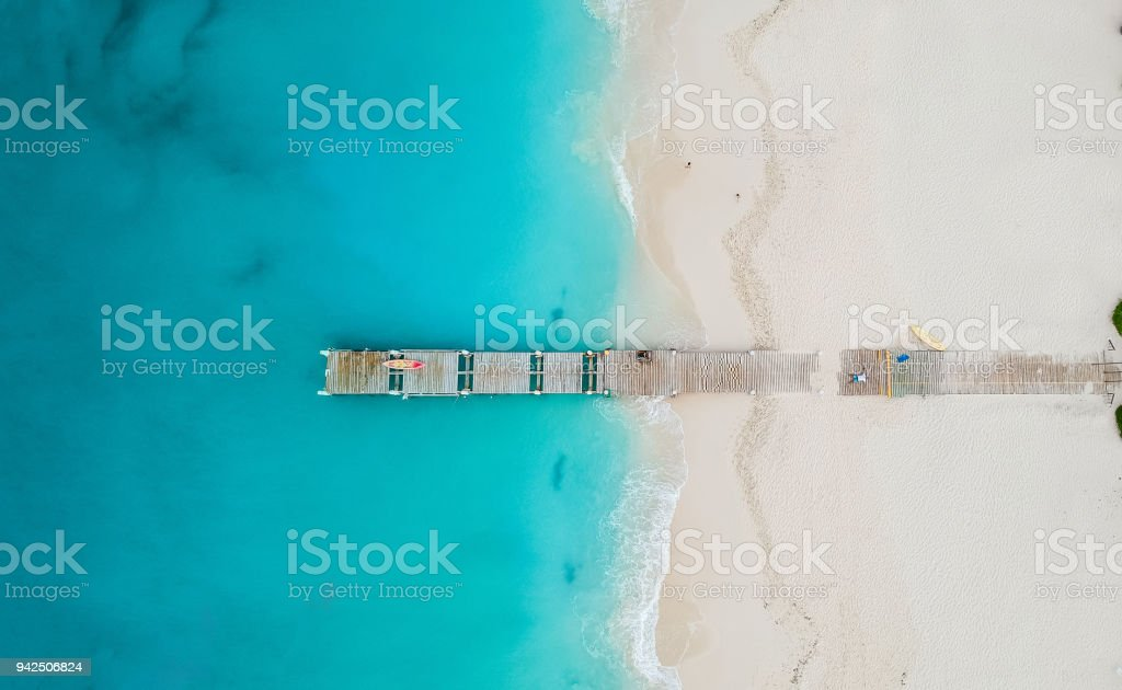Drone panorama of pier in beach in Grace Bay, Providenciales, Turks and Caicos stock photo