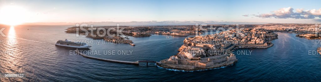 Drone photo - Cruise ship entering Valletta, Malta at sunrise stock photo