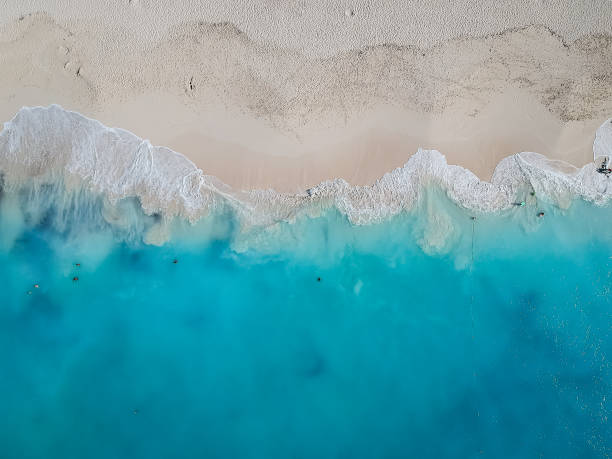 drone photo grace bay, providenciales, turks and caicos - beach stock pictures, royalty-free photos & images