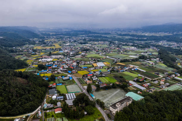 Drone photo - Mountains and fields of Gunma Prefecture, Japan. stock photo