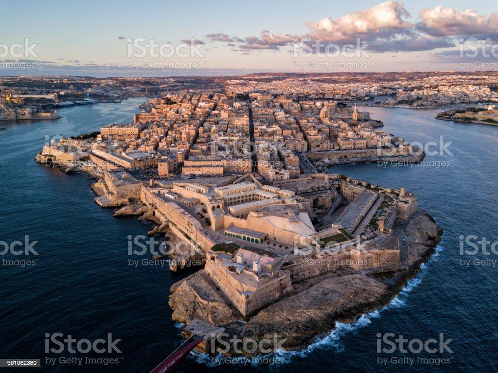 Drone photo - Sunrise over the city of Valletta, Malta. stock photo