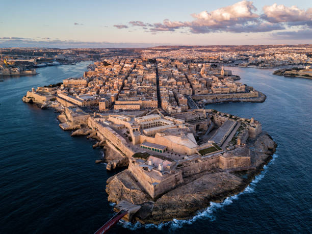 Drone photo - Sunrise over the city of Valletta, Malta. stock photo