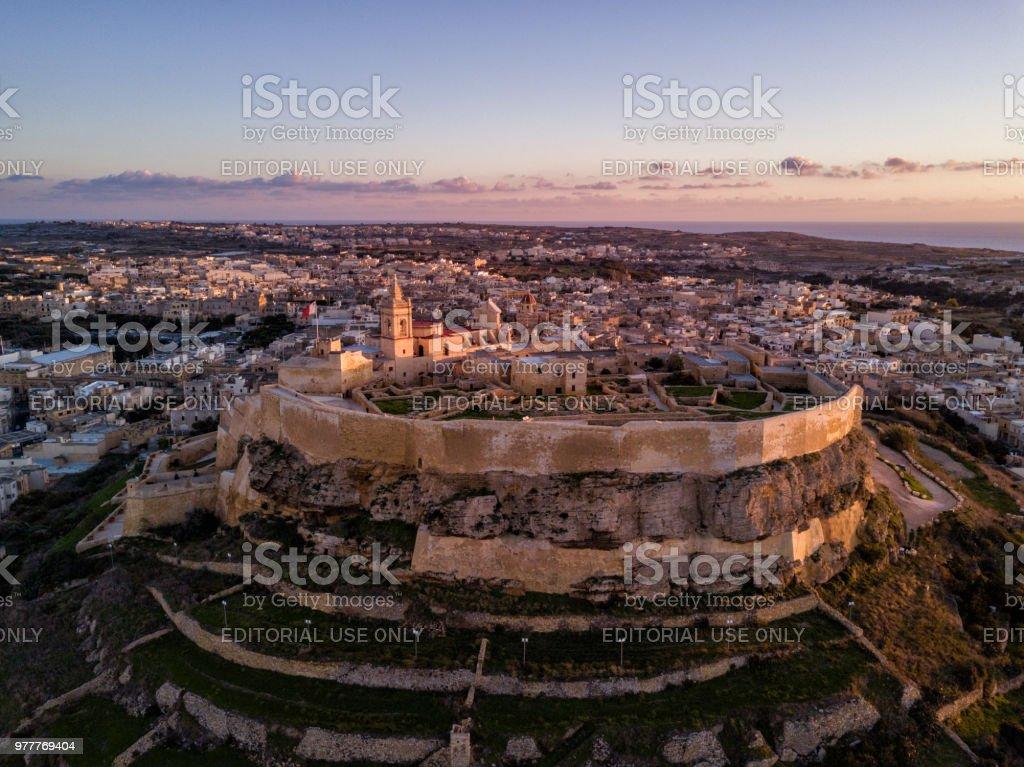 Drone photo - Sunset over the Gozo Citadel, Malta stock photo
