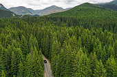 istock Drone photograph with Trans Bucegi mountain road high up in the Carpathian Mountains. 1257238811