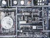 Drone point of view above Oil refinery and gas industry in Petrochemical plant  showing steel pipe line background