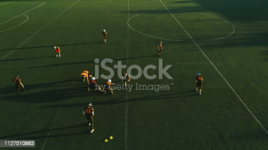 1176737230istockphoto Drone point view of American football game 1127510863