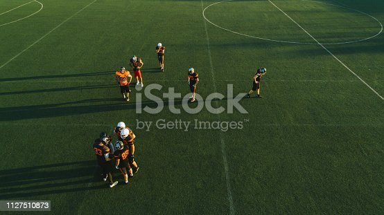 1176737230istockphoto Drone point view of American football team 1127510873