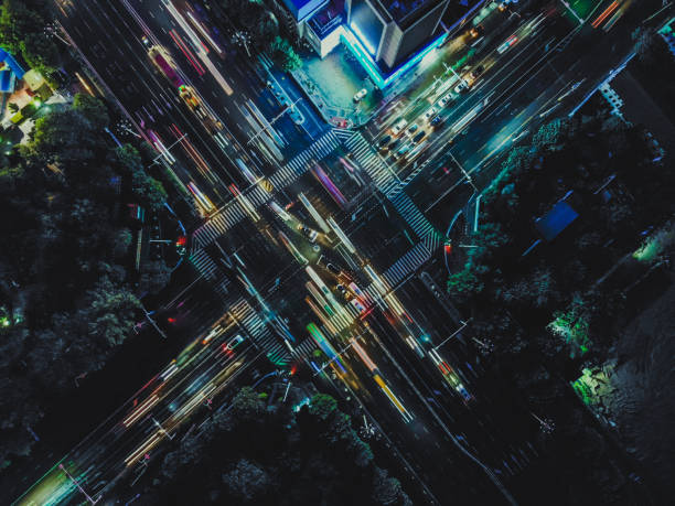 Drone Point View of City Street Crossing at Rush Hour, Long Exposure stock photo