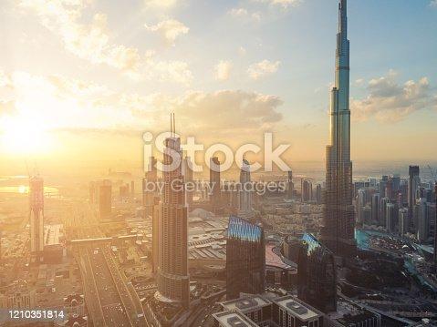512697874 istock photo Drone Point View of Dubai Skyline at Sunrise 1210351814