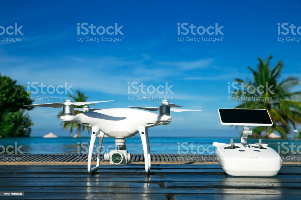 drone quad copter with high resolution digital camera and its remote control pad with smartphone stock photo