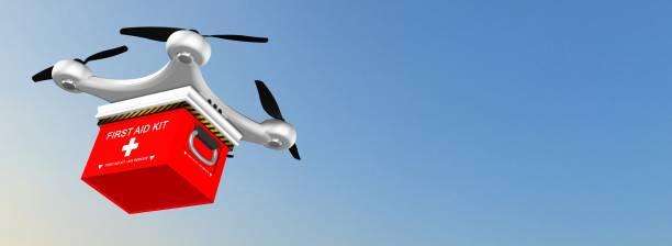 drone quadrocopter liefert eine erste-hilfe-kit in den himmel - was bringt unglück stock-fotos und bilder
