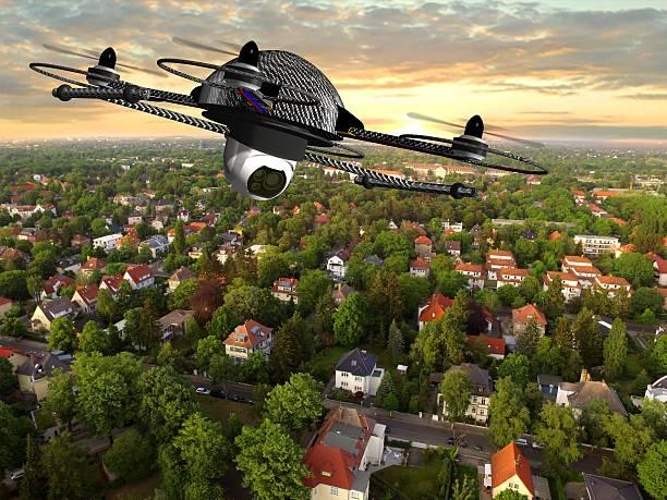 drone quadrocopter with camera in flight over over suburban houses - flugdrohne stock-fotos und bilder