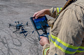 istock Drone remote control in hand man.Man operating of flying drone 1287859637