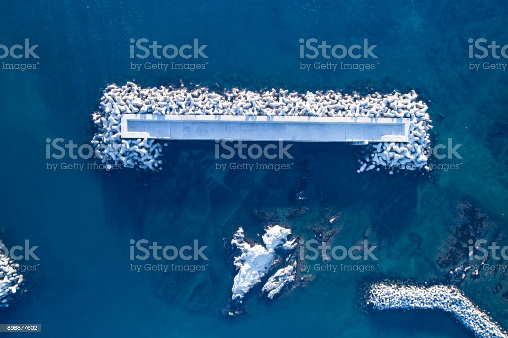 Drone shooting. blue sea. White blocking wave. stock photo