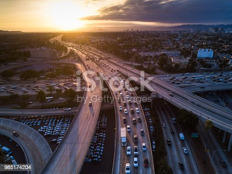 Drone shot of the I-10 / I-110 Interchange on the edge of Downtown Los Angeles at sunset.