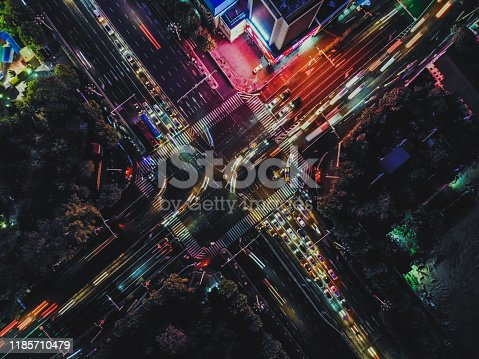 istock Drone Shot of City Street Crossing at Night 1185710479