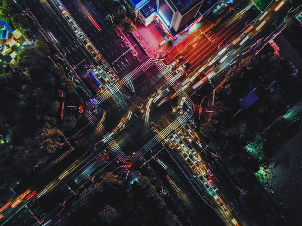 Drone Shot of City Street Crossing at Night stock photo