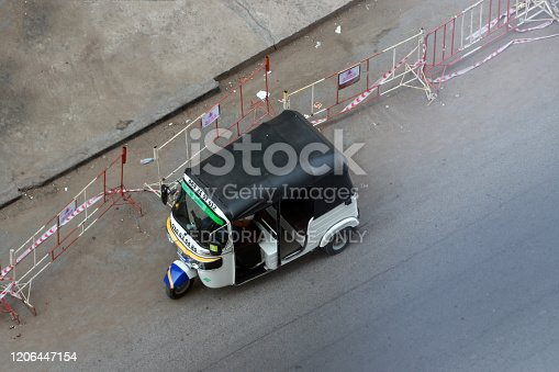 Phnom Penh, Cambodia, Feb 5, 2020 : Drone shot, Tuk Tuk or Taxi tricycle on the road, Lifestyle of traffic in Phnom Penh. It is a three-wheeled motorized vehicle used as a taxi.