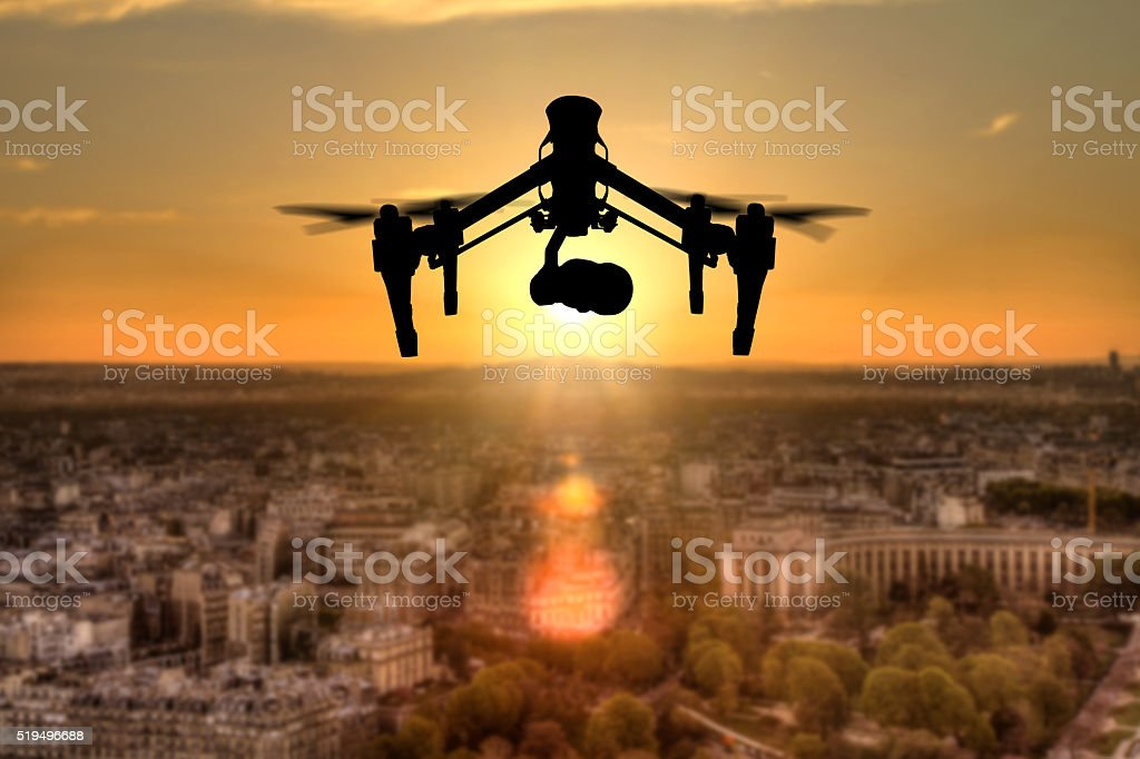 Drone silhouette flying above Paris city panorama stock photo