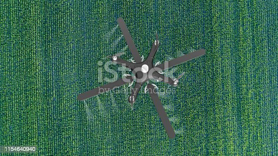 898449496istockphoto Drone spraying a field 1154640940