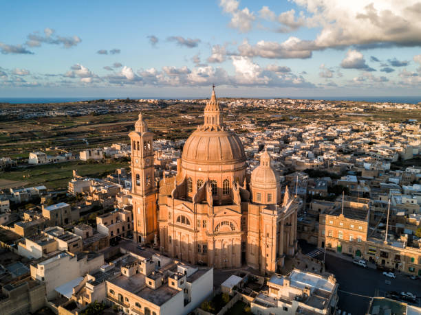 Drone sunrise - Rotunda St. John Baptist Church.  Gozo, Malta stock photo