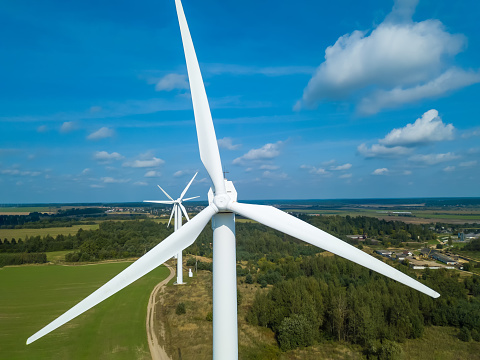 Drone view of a wind turbine on a Sunny day. Environmental friendliness, the concept of renewable energy sources.