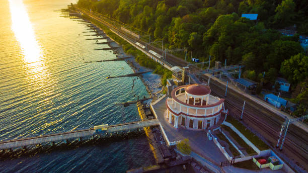 Drone view of Matsesta marine station, Sochi, Russia Drone view of the pier and the Matsesta marine station near the railway station in summer day at sunset, Sochi, Russia sochi stock pictures, royalty-free photos & images