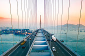 istock Drone view of Stonecutters Bridge and the Tsing sha highway at sunset 1199136578