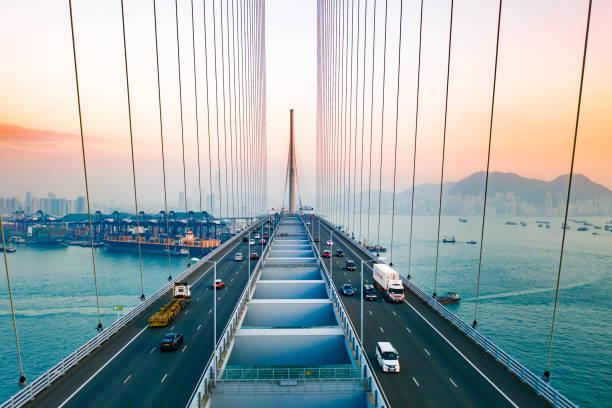 drönarvy över stonecutters bridge och tsing sha highway vid solnedgången - hongkong bildbanksfoton och bilder