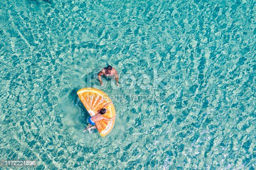 Drone view of swimming people