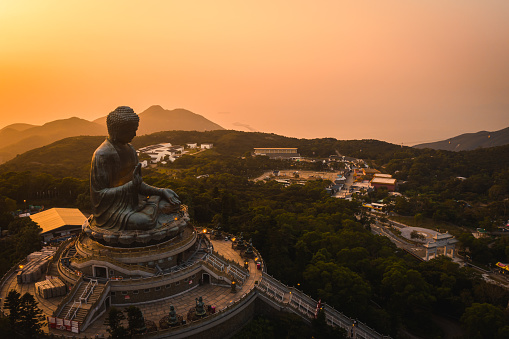 Drone view of The Big Buddha is lit in the evening